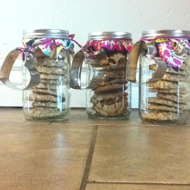 Thank you gifts! Cookies in mason jars with cookie cutters tied around the lid. Decorative fabric makes it more personal.