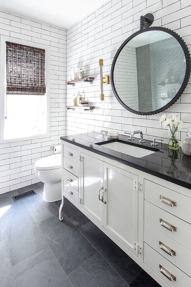 Slate On The Floor With A White Furniture Style Vanity With A Black Quartz Countertop Round Black Mi Black Tile Bathrooms Black Bathroom Floor White Bathroom