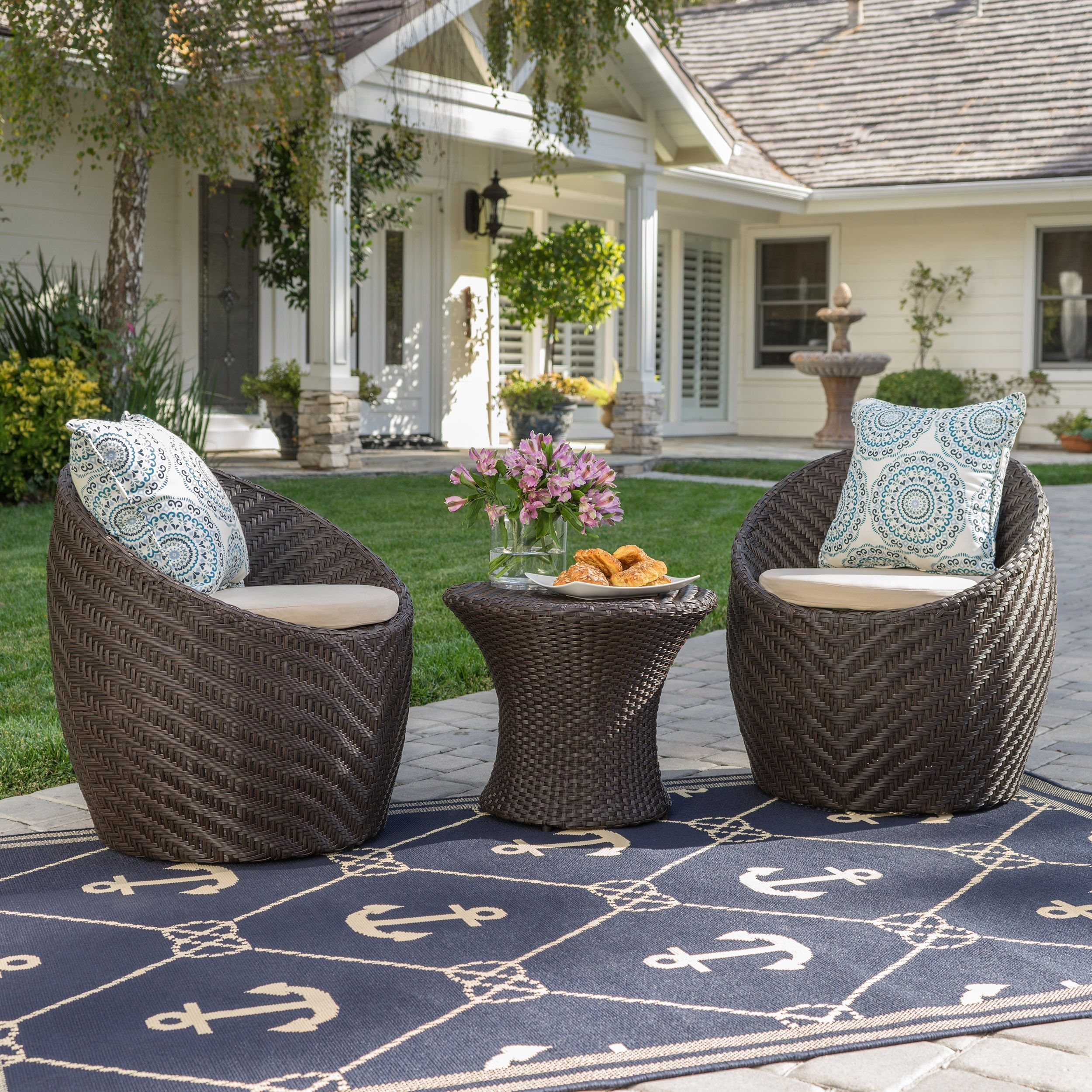 Antigua brown outdoor piece chat set with nautical rug by