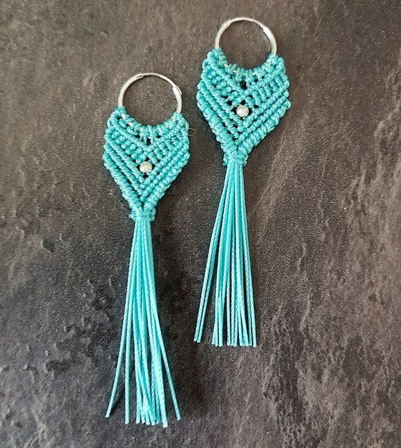 Macrame earrings in shades of teal and turquoise on sterling silver earhooks and a silver bead. They measure 8 cm (3