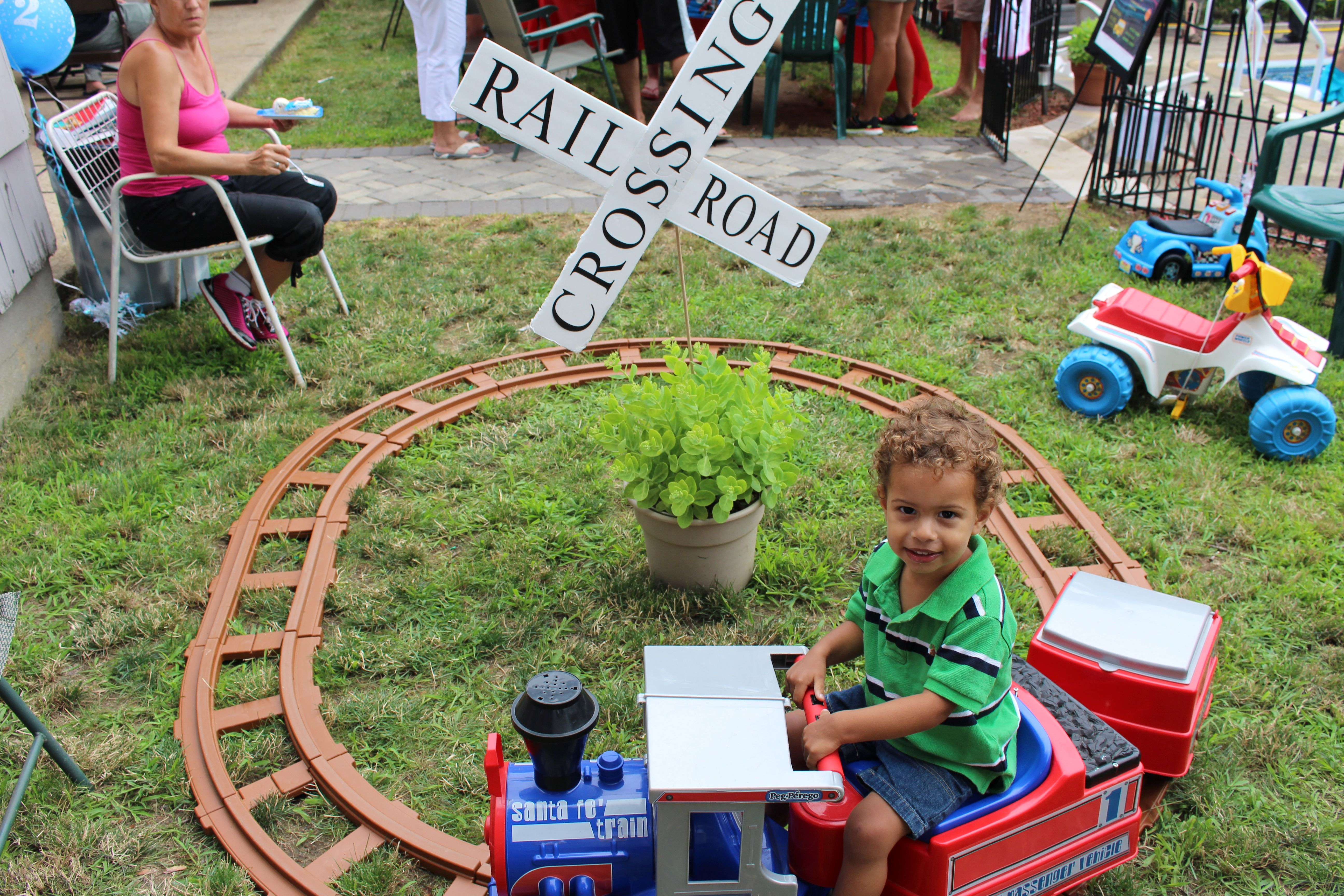 Rail Road crossing sign.  Took foam board and cut out letters and glued onto foam board.  Already had the train!
