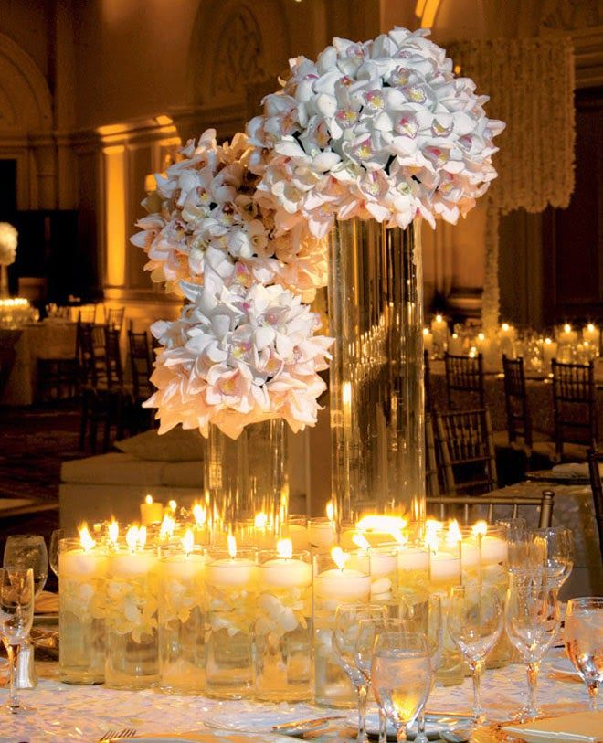 Stunning white orchids and candlelight reception