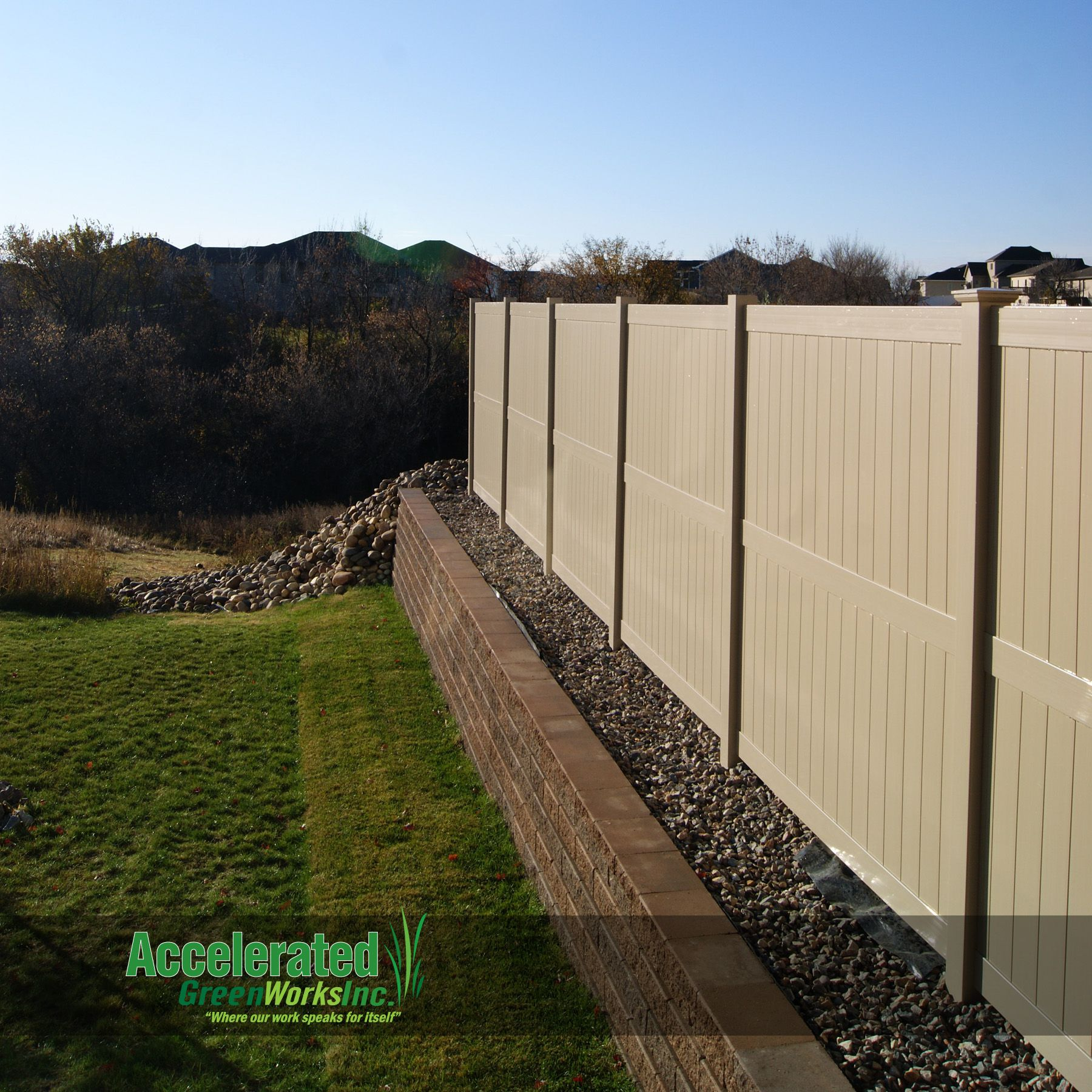 This Is An 8 0 Tan Vinyl Privacy Fence Atop A Short Versa Lok Retaining Wall The Neighbor On Th Backyard Retaining Walls Retaining Wall Vinyl Privacy Fence