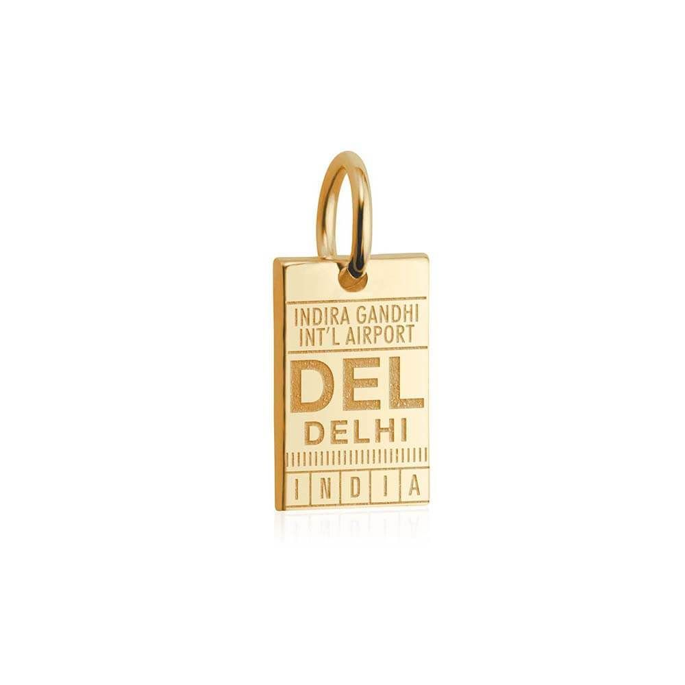 """Your 14k solid gold Mini Delhi Luggage Tag Charm features the IATA code for Indira Gandhi International Airport, DEL. Take home a timeless memento of the """"City of Cities."""" Lose yourself in the whirlwind of rickshaws, carts, cows, and culinary delights down the streets of Delhi. It's a sensory overload. Approximate dimensions: 6.8 mm x 11 mm"""