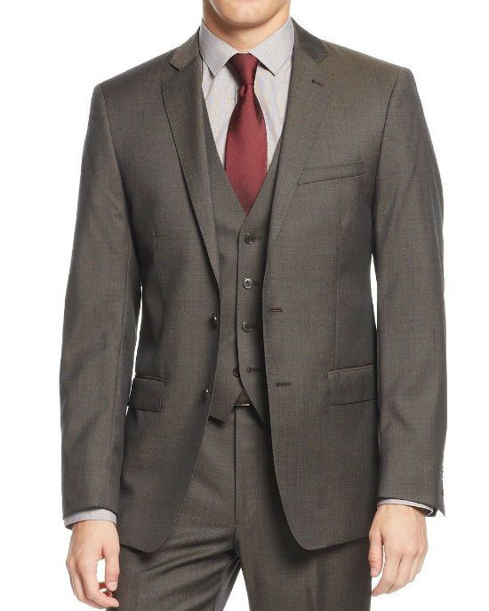1b6a09a3430f52 Complete a sharp look with this sharkskin suit from Calvin Klein, featuring  a slim-fit design and brown hue. Jacket: peak lapels; external chest pocket  at ...