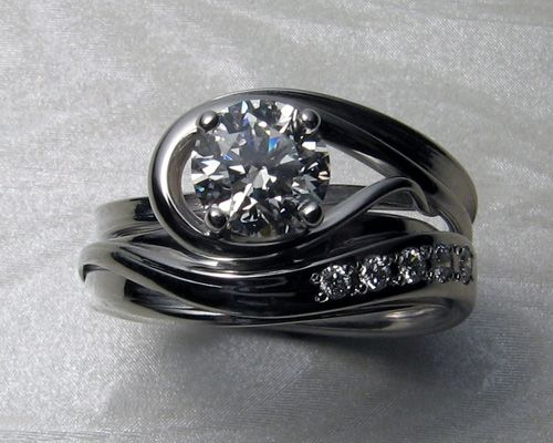 Very unusual custom made engagement ring with matching wedding