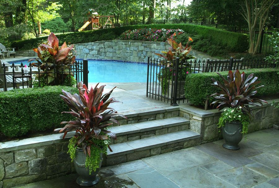 Pool With Retaining Wall Google Search Backyard Pool Landscaping Sloped Backyard Pool Retaining Wall