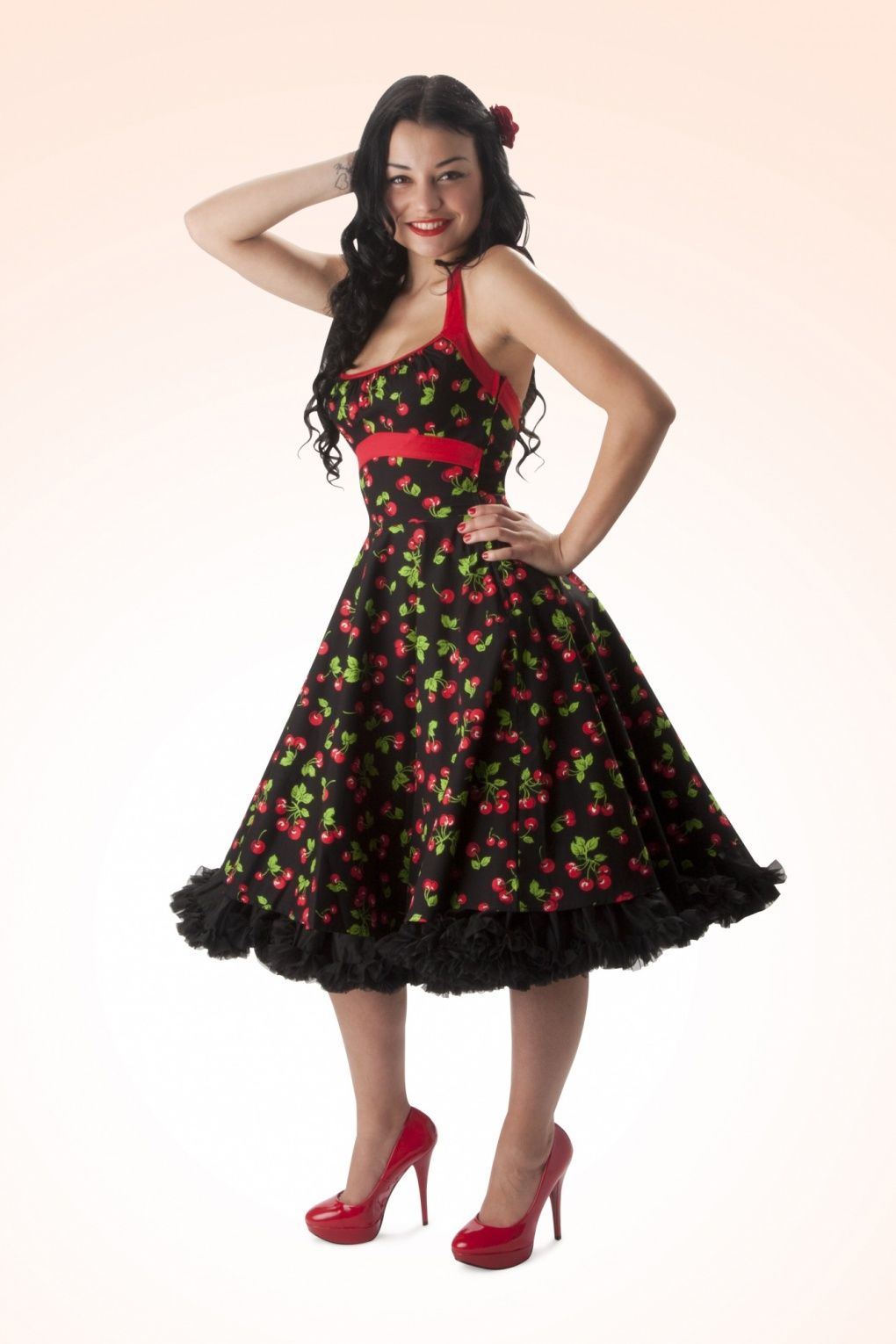 The Daisy cherry swing dress is one of the most popular dress silhouettes from Pinup Couture, with its fun, flirty, and very feminine cut.
