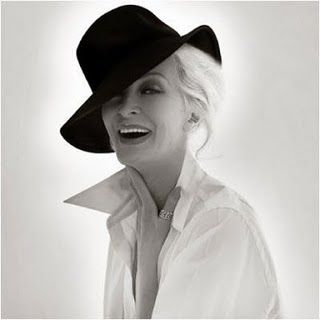Carmen Dell'Orefice, now 80 proves to be not only the oldest working model, but a queen on the runway and print both commercially and editorially.  She is fabulous.