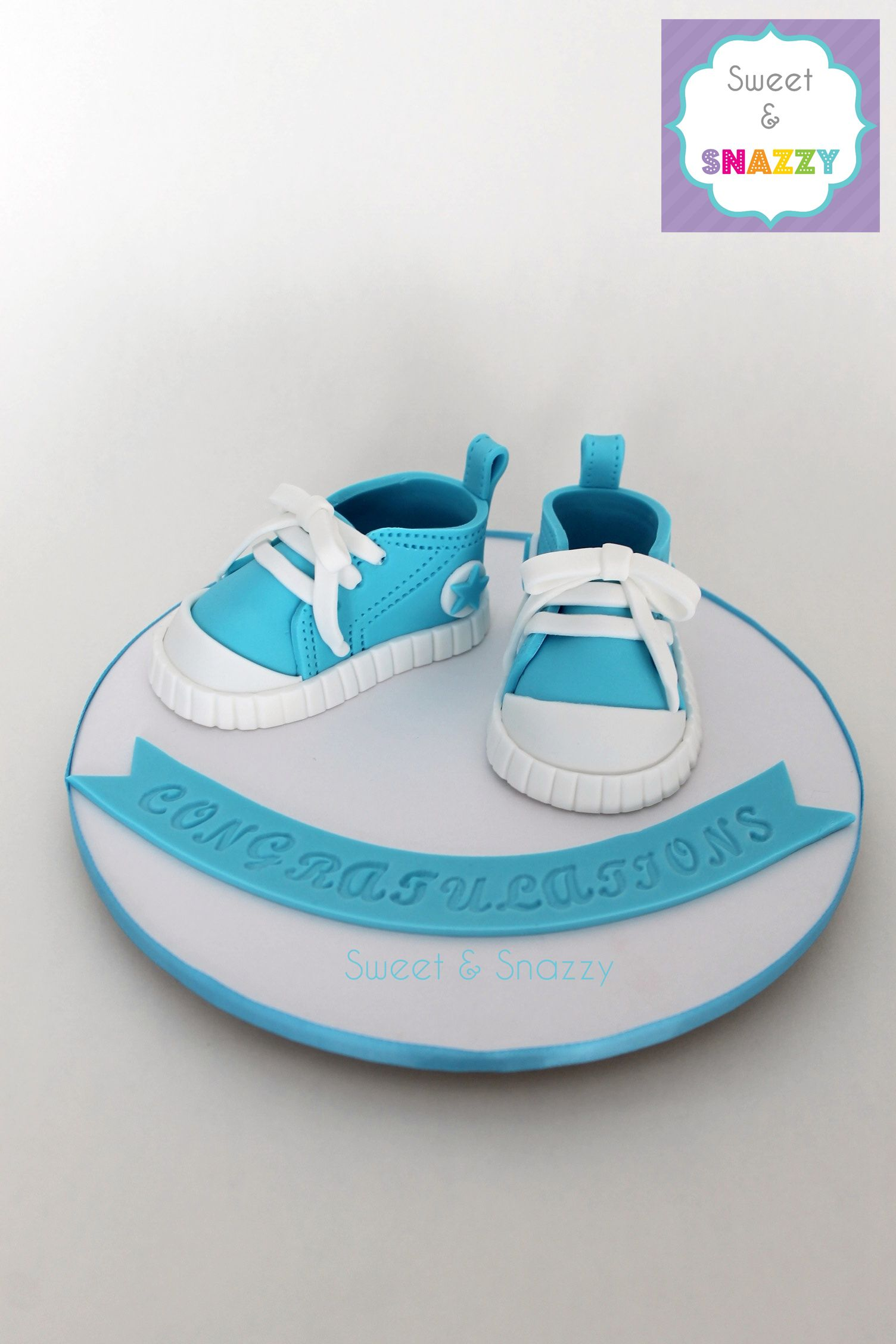 Baby Converse shoes cake topper - fondant baby shoes by Sweet & Snazzy https://www.facebook.com/sweetandsnazzy