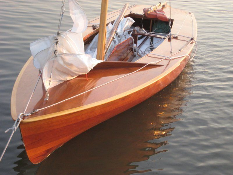 A late 1950's International Flying Dutchman Class sailboat. The Mahogany hull was cold-moulded in Holland and imported by Paul Rimoldi of Miami Florida. Mr Rimoldi made everything else, including many pieces of hardware. He raced the boat on Biscayne Bay into the 60s and sailed it for many years later. He rebuilt the boat in the late '80s
