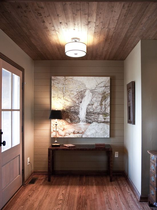 wood ceiling, trim and floors. Ceiling is more rustic looking.
