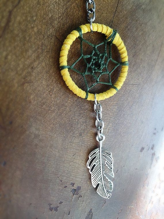 This yellow dream catcher keychain with feather charm is the perfect accessory for your keys, car, or purse! These make great gifts, Christmas Stocking Stuffers and more.
