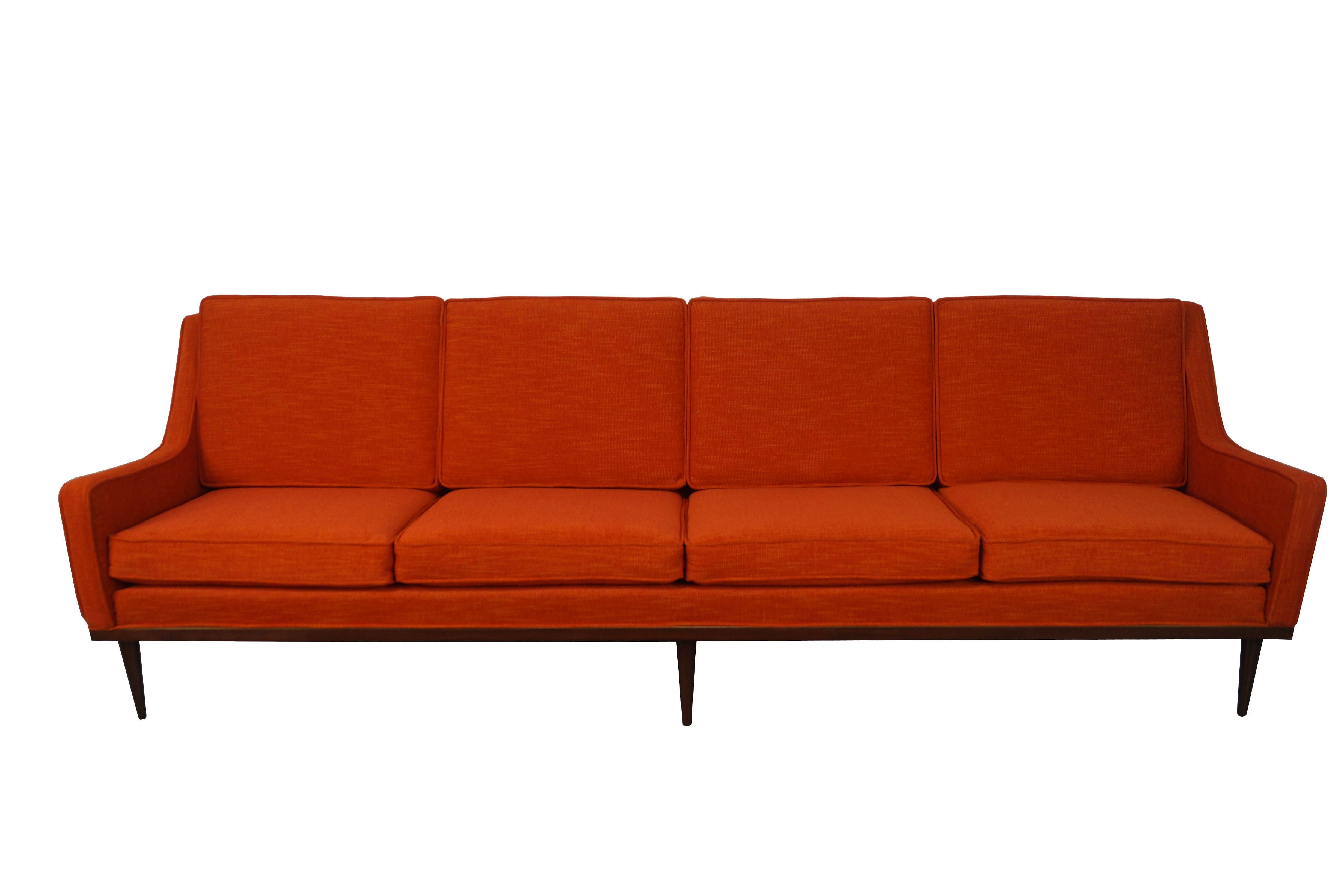 Loose cushions on a four seater sofa with walnut base designed by Milo Baughman for James Inc. A divine sofa with classic Mid-Century style tapered legs. A gorgeous addition for any space in need of vintage fabulousness!