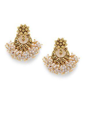 Chandbali pearl earrings I found this beautiful design on Mirraw.com