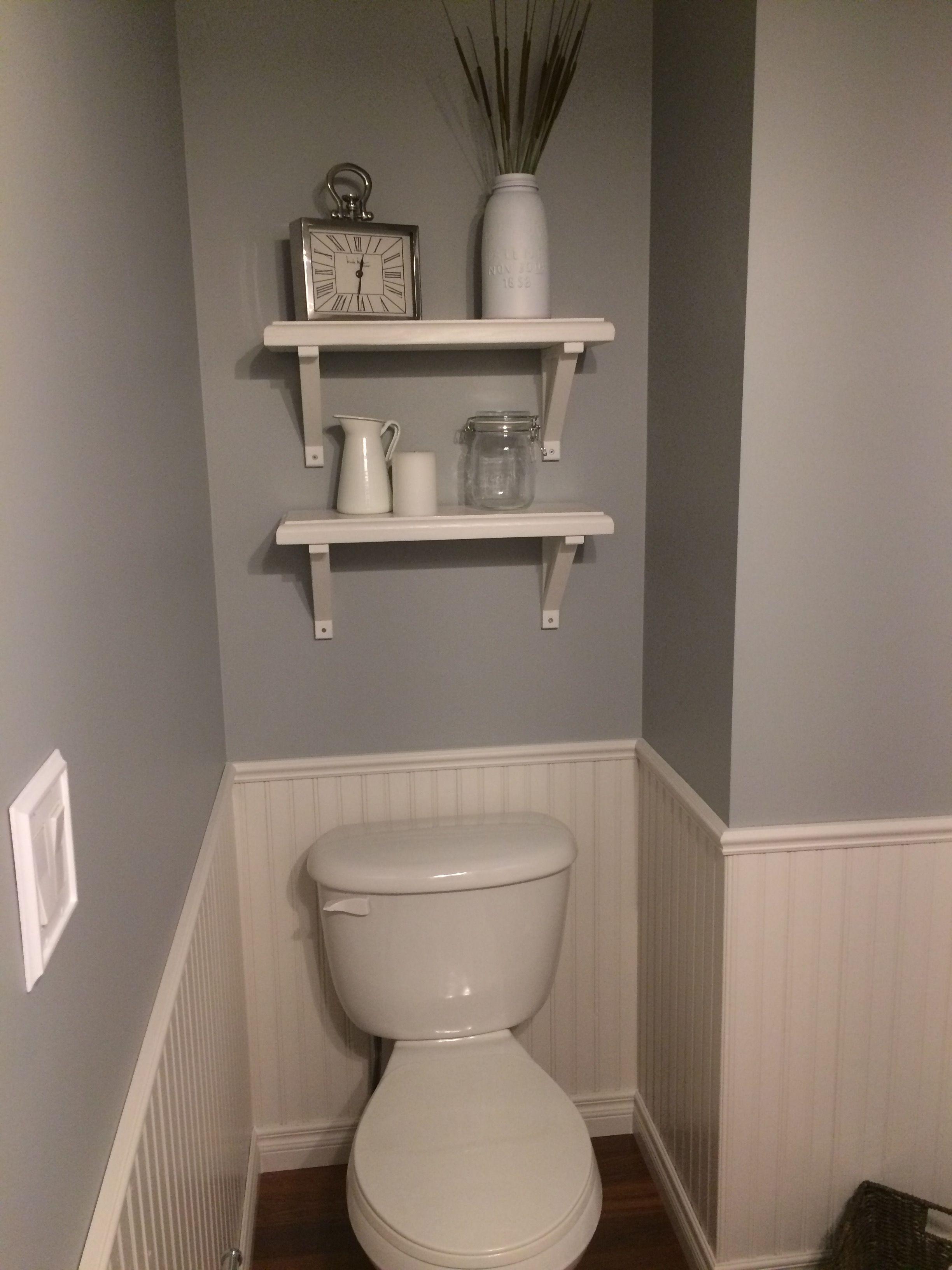 Farmhouse bathroom shelves in white and gray bathroom