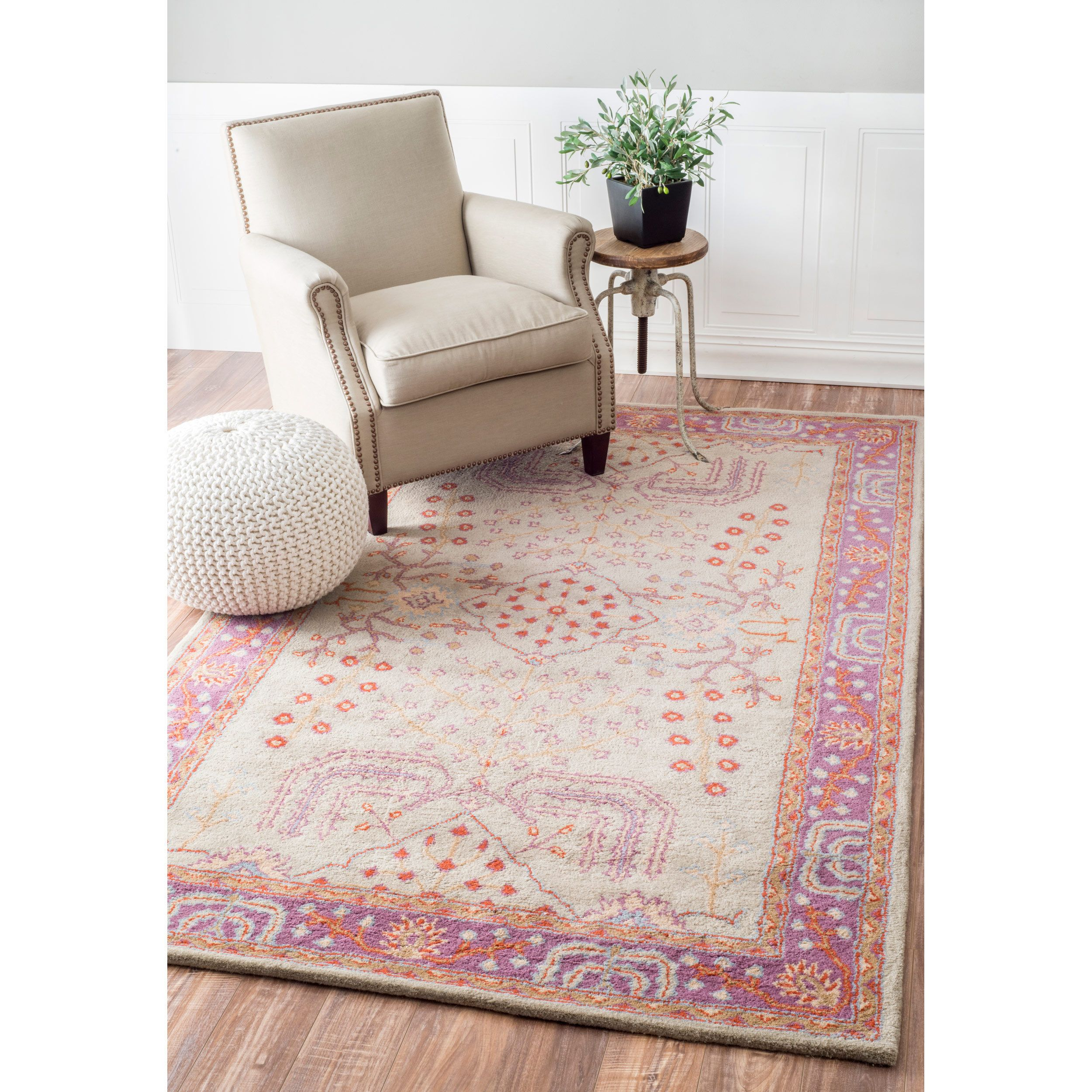 This handmade area rug uses subtle and modern colors to match today's interiors. Made with both Indian and New Zealand wool, the pile is very plush and will add the look of luxury to any room.