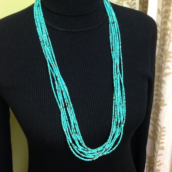 """9 Strand Seed Bead Necklace Turquoise Multiple stand necklace made of tiny seed beads in turquoise and cooper colors. Silver tone clasp. Adjustable from 31-33"""" inches Boutique Jewelry Necklaces"""