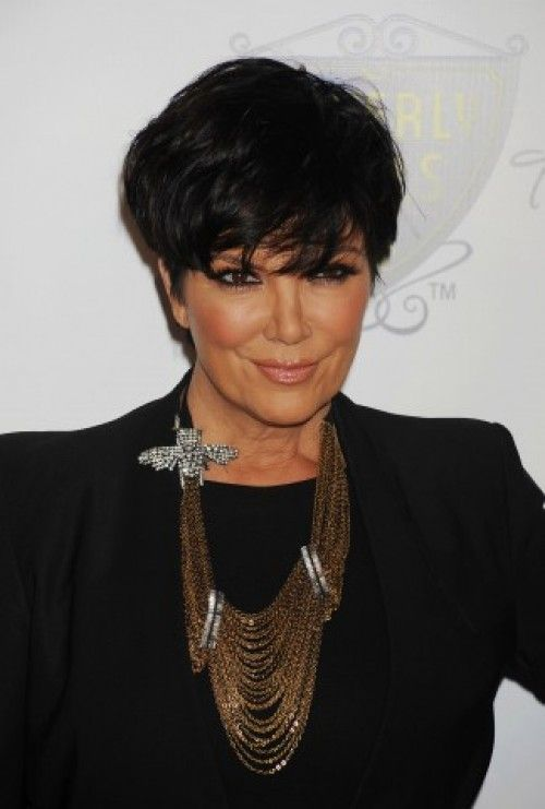 Kris Jenner's Sexy Bangs  Kris Jenner's sexy bangs are really part of a very versatile crop that allow her to wear the style brushed down, pictured, or worn brushed back and a bit spikier. Rich color really sets this cut apart from the rest.