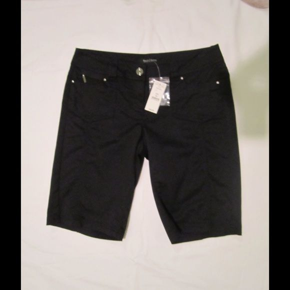 """White House Black Market NWT Size 00 Shorts NWT WHBM black Bermuda shorts in size 00. 2 front and 2 back pockets embellished with silver studs and decorative threading. 63% cotton, 34% poly, 3% spandex.  Mach wash cold, td low. W=29.5"""", rise=7.25"""", inseam = 10.5""""   A great, and very comfortable, pair of shorts to have on hand! White House Black Market Shorts"""