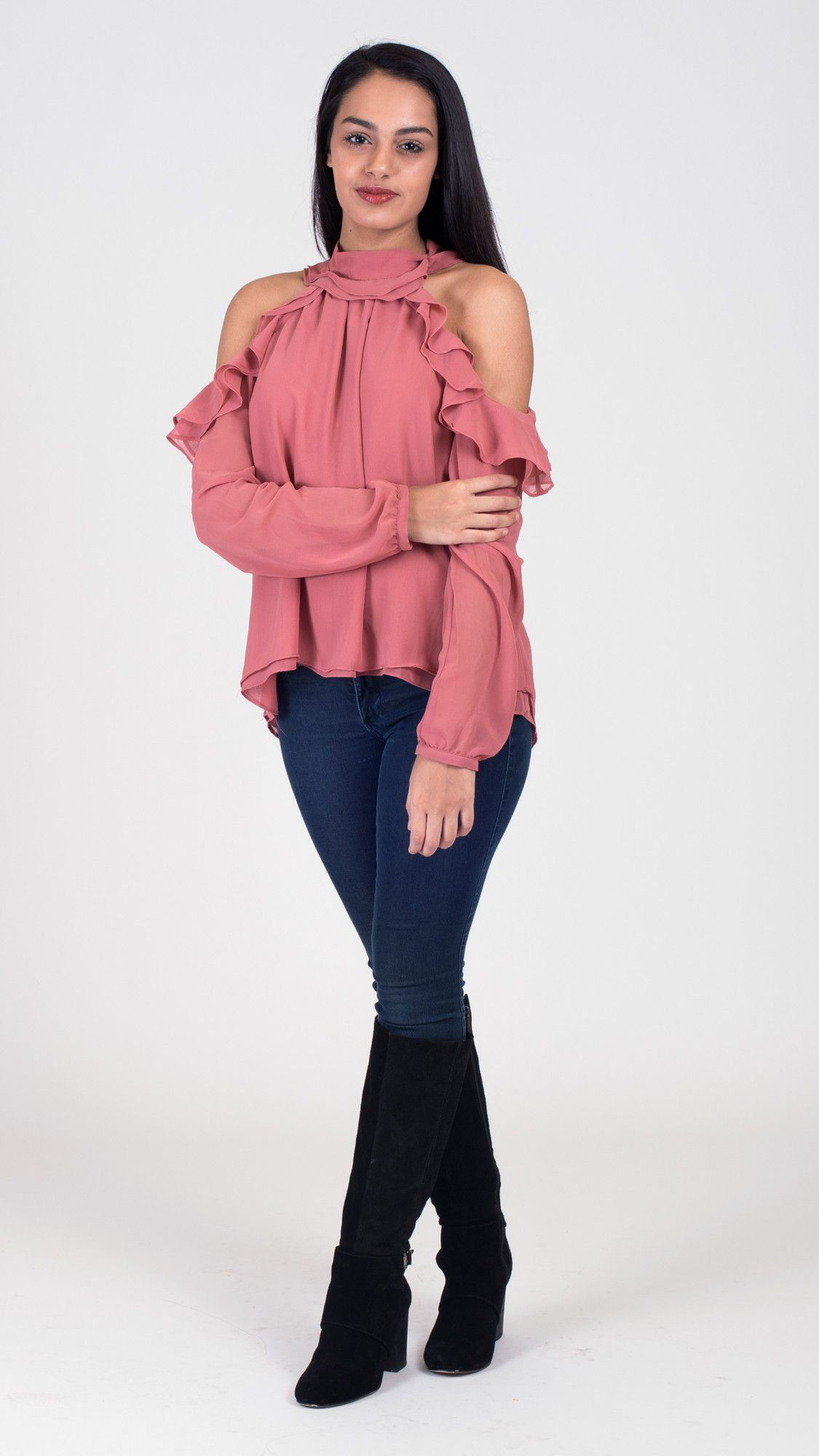 7371b803f25aa8 Beautiful pink cold shoulder top with high neck and ruffles. A ruffled top  is perfect for your spring wardrobe! I Do Declare Boutique