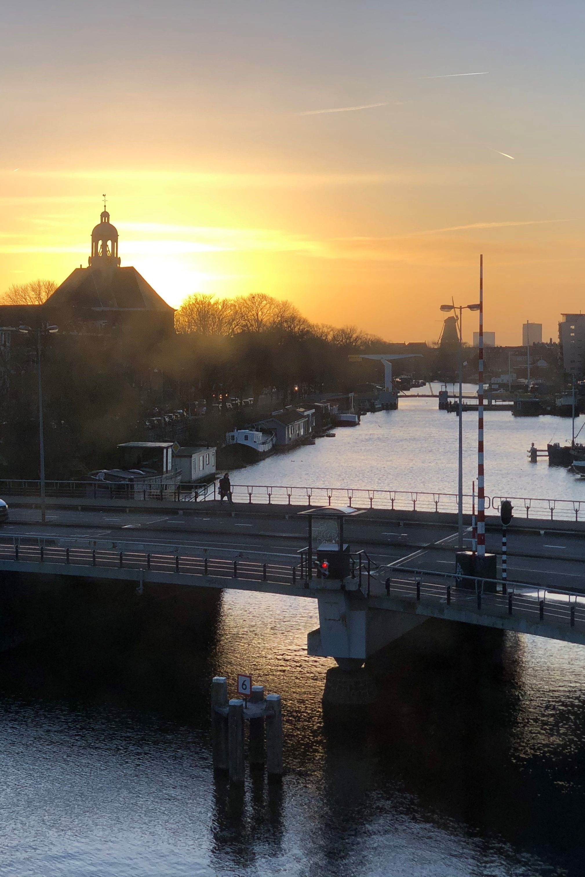 Imagine waking up to views like this! At bridge house 202 - Kortjewantsbrug, you can. Book your spring or summer stay now via the link in this post.  Picture by Ed Krommenhoek.  #sweetshotel #amsterdam #hotel #hotels #traveltips #travelguide #travel #travelling #travellers #view #getaways #destinations #netherlands #holland #unique #unusual #trip #citytrip #europe #destination #visit #bridge #house #tinyhouse #brugwachtershuisje #kadijksplein