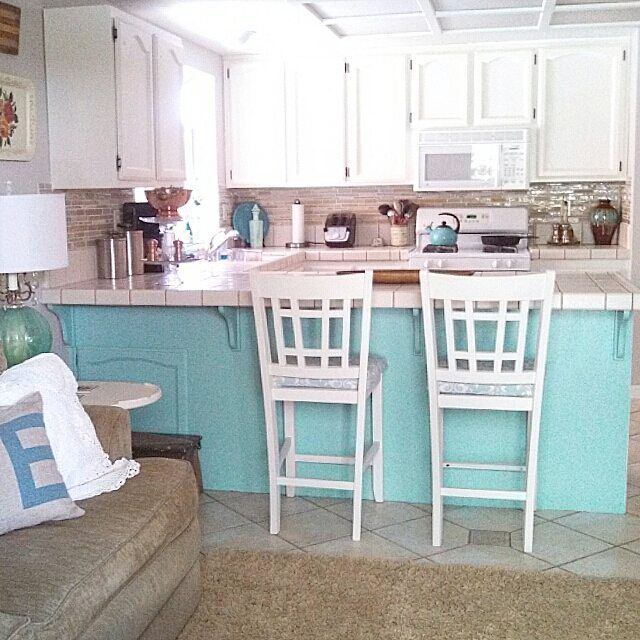 I like how they added a pop of color by painting under the counter and I like the backsplash