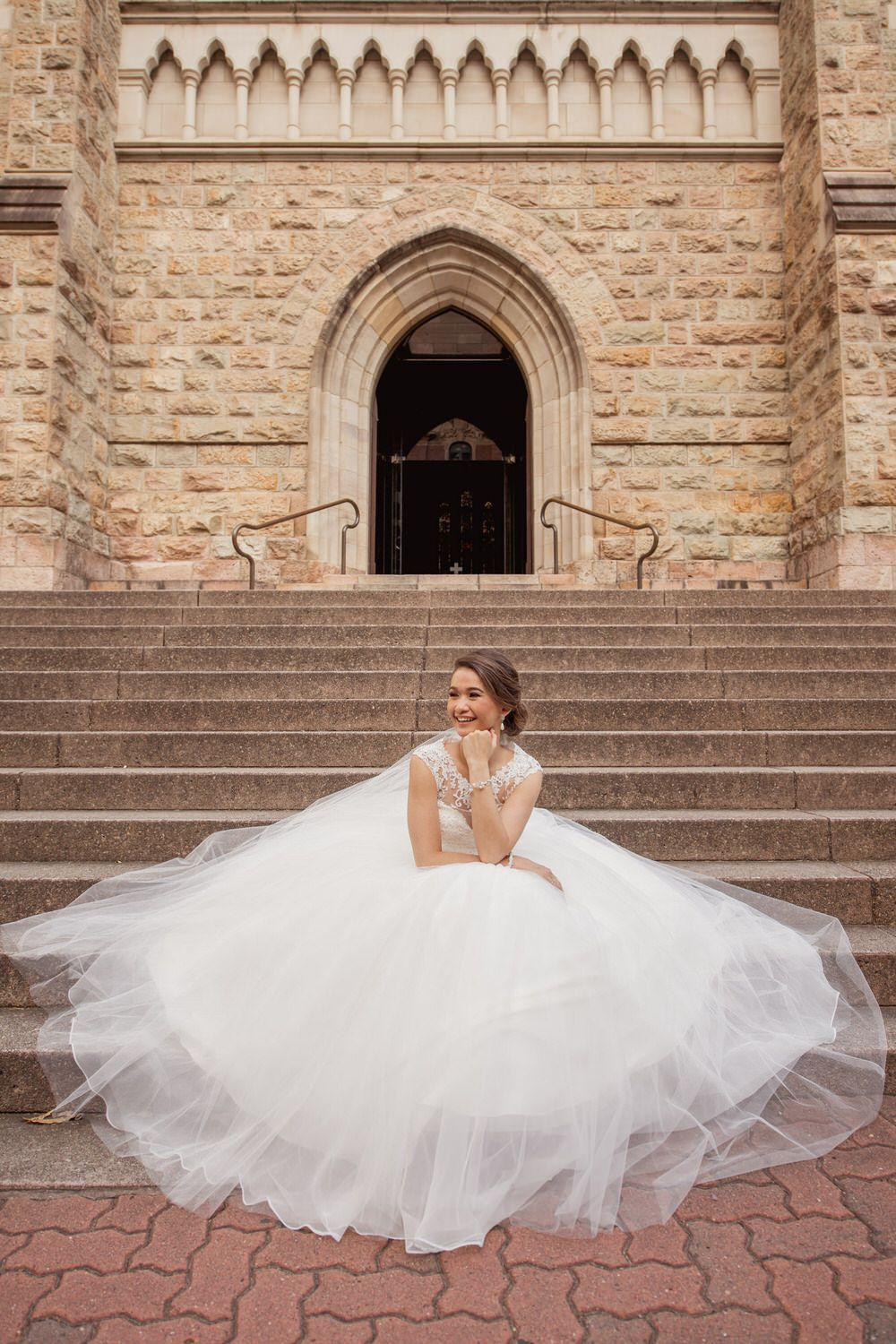 A traditional wedding with blush colours two wedding dresses