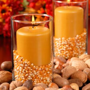 Fall Decorations from Home Furnishings. Popcorn kernels in candle holder! Cute idea!