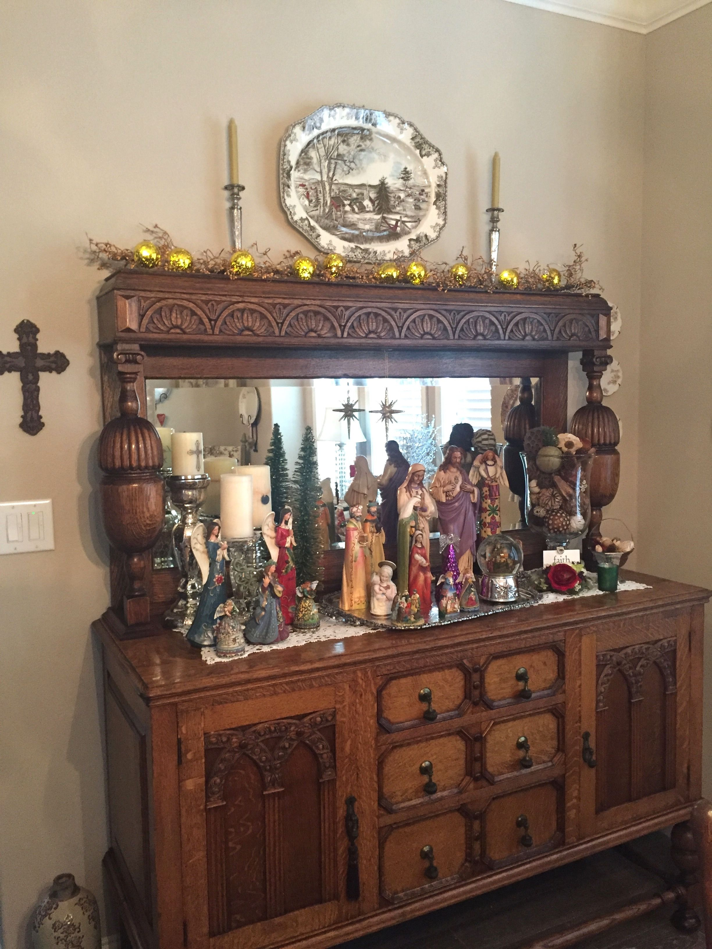 My version of a Nativity Scene.  Antique Quarter-Saw Oak Buffet with my collection of religious statues, some given to me by my grandmother and great grandmother.