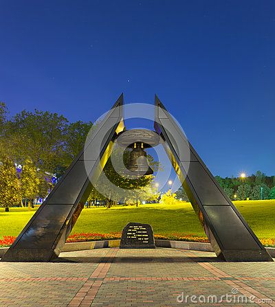 Memorial Monument With Bell In Park Near Stadium In Donetsk - Download From Over 23 Million High Quality Stock Photos, Images, Vectors. Sign up for FREE today. Image: 40769302