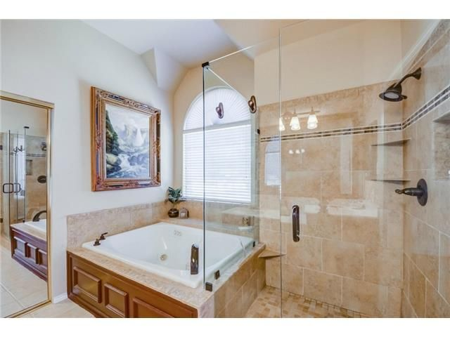 Great set up // Glass shower, jetted tub under the window with natural light