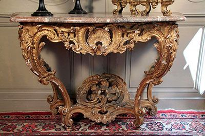 Very fine, French, early Louis XV period console: In solid, carved giltwood with original marble top.