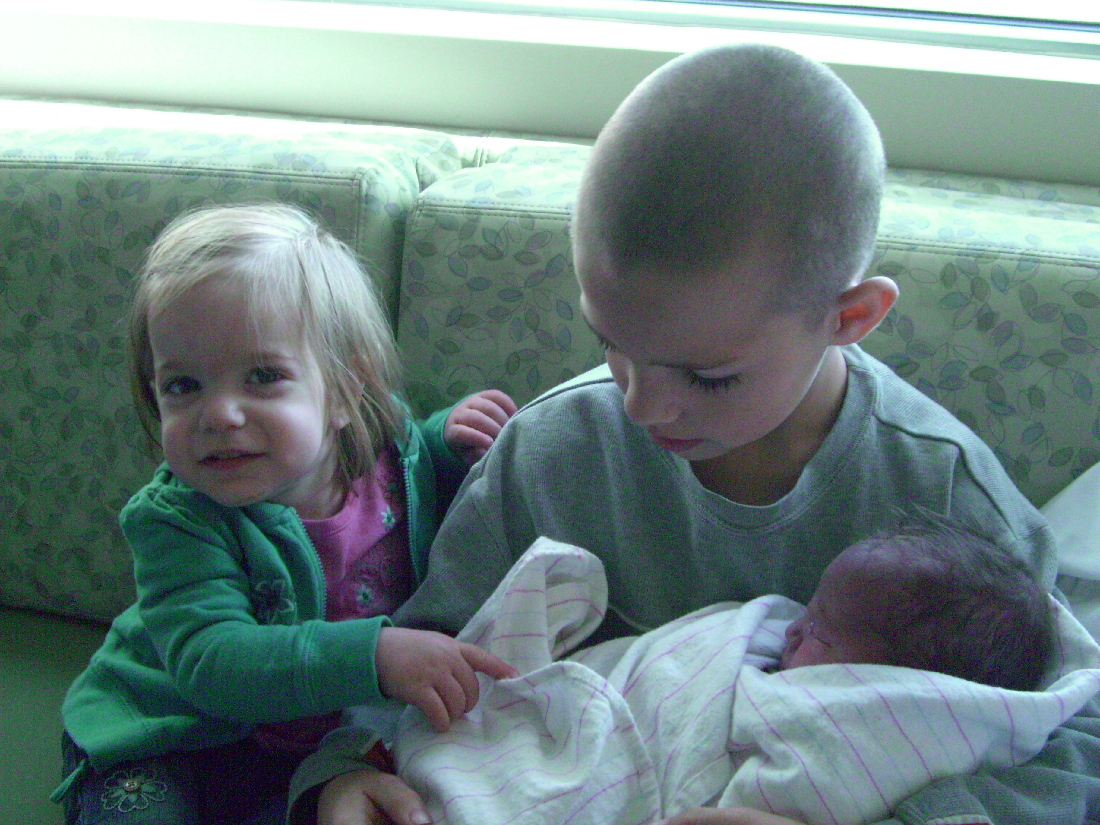 Teaching Children To Welcome A New Sibling