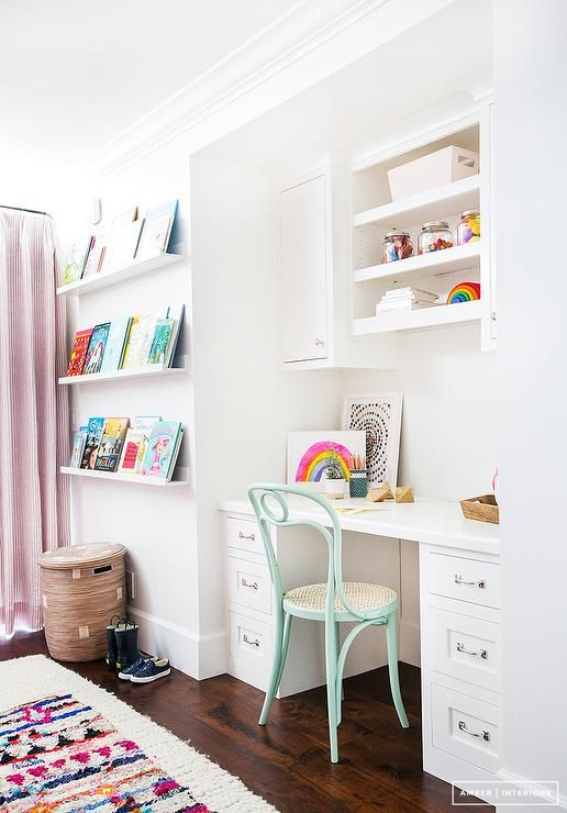 White kids room with pops of color boasts a built in white desk ...