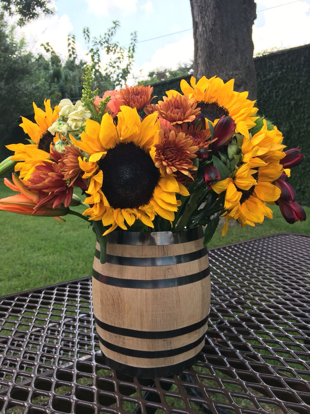 Small Wood Barrel Vase Filled With Sunflowers Mums And Other Autumn Colored Flowers Barrel Flowers Flower Vase Making Sunflower Arrangements