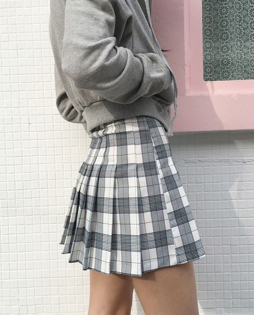 69e26f223df this mini skirt is similar to the 1967 s green skirt because if the length  and the pelted style as well as the plaid.