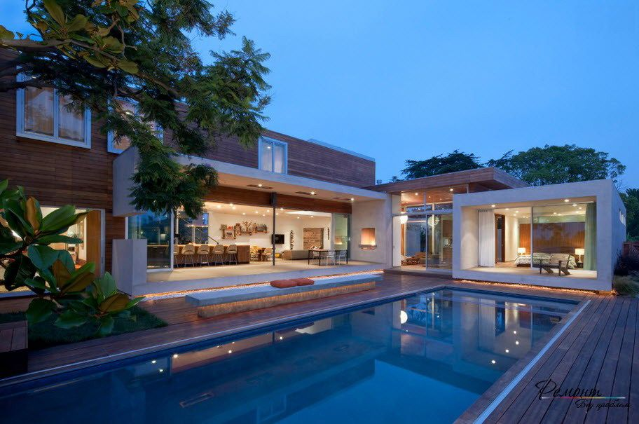 Elegant Swimming Pool With Wooden Deck And A Long Bench In Beautiful Villa Neoteric