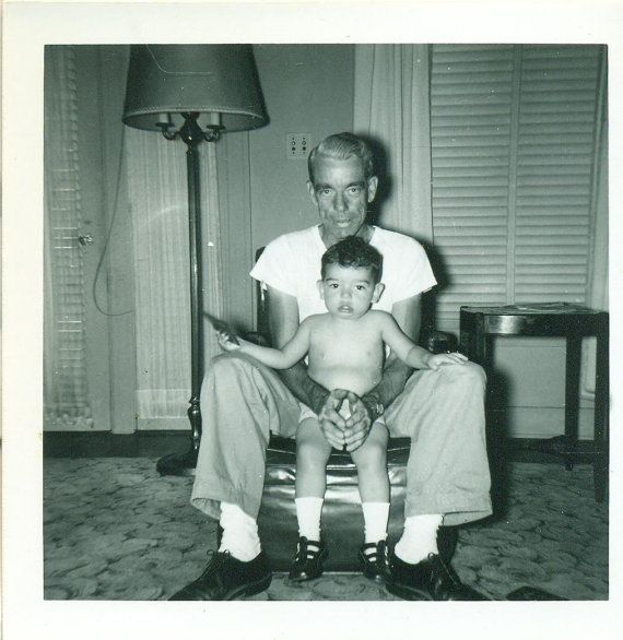 In Grandpa S Arms Baby Boy With Old Man Sitting In Chair 1950s