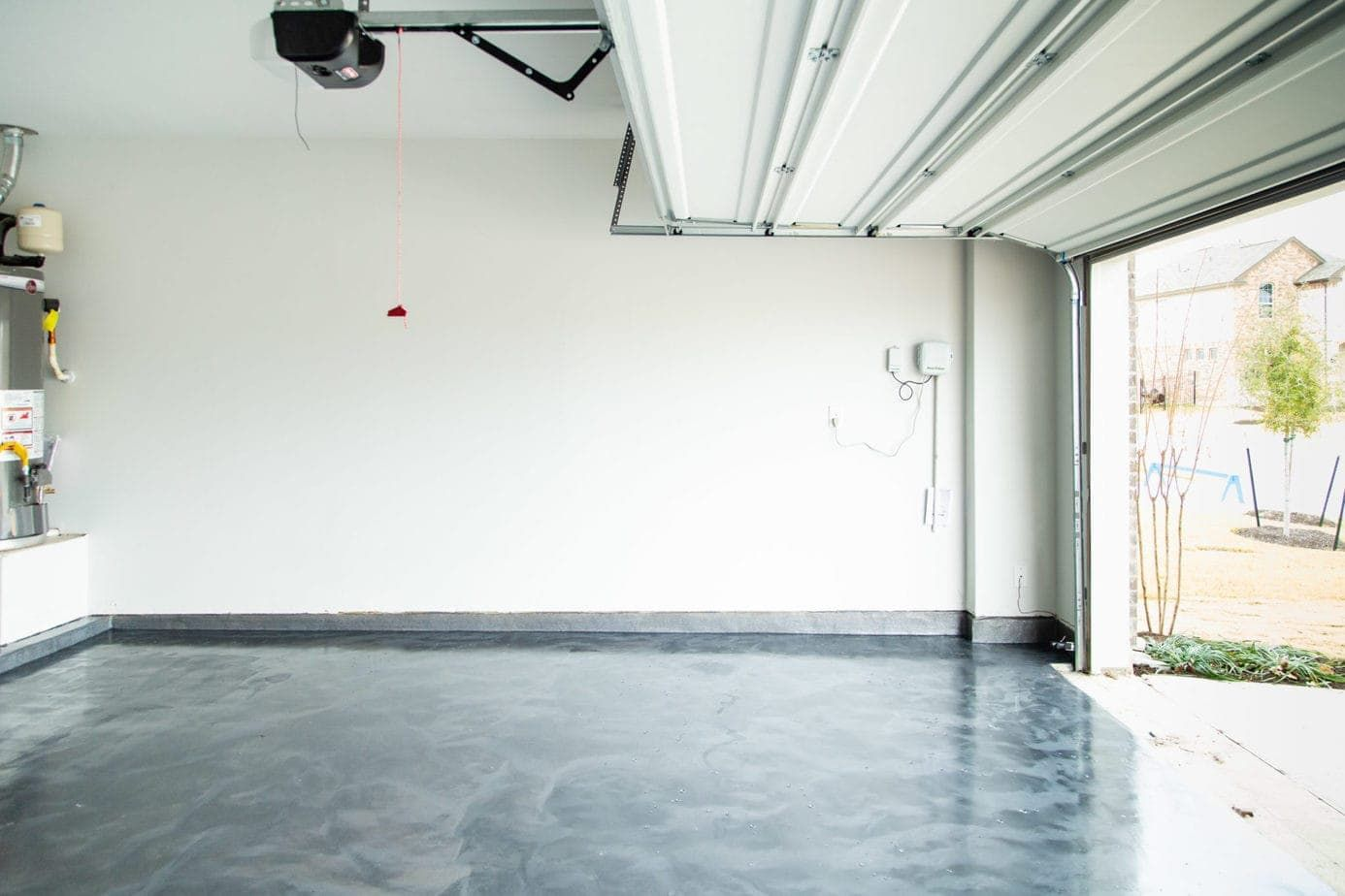 How to apply a DIY epoxy floor coating in your garage. #diy #diyproject #garage #epoxyfloor #prideinthemaking #rustoleum