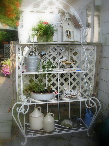 Well Placed Baker S Rack Helps To Create A Privacy Wall While