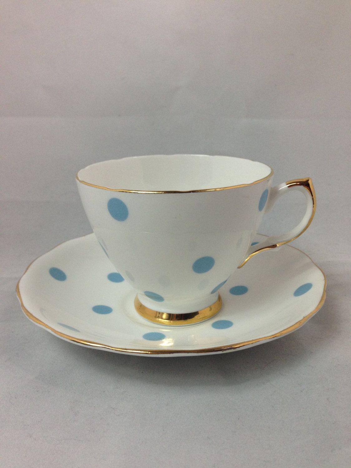 Vintage royal vale tea cup and saucer bone china with blue for Gold polka dot china
