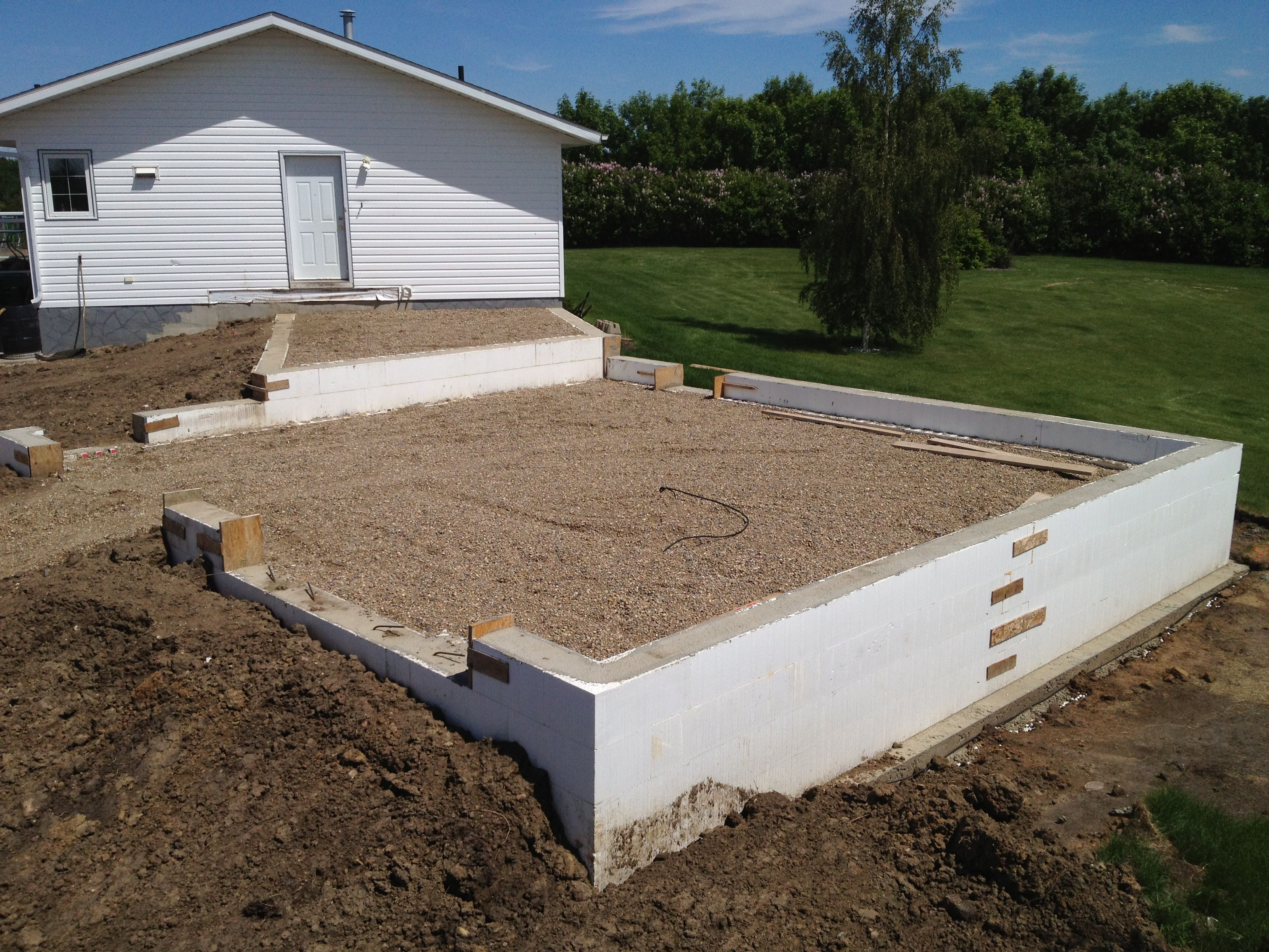 Icf frost walls on footings start the project entryway for Icf basement construction