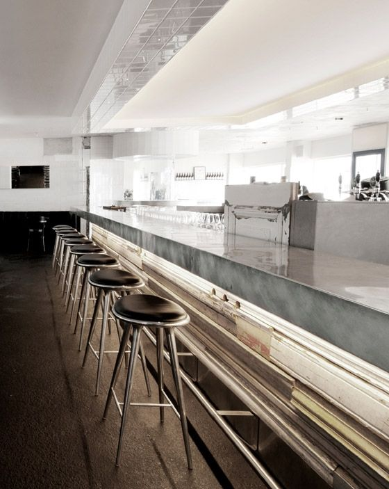 Fiskebaren - fish restaurant in Copenhagen's meatpacking district | shiny bar and Mater stools