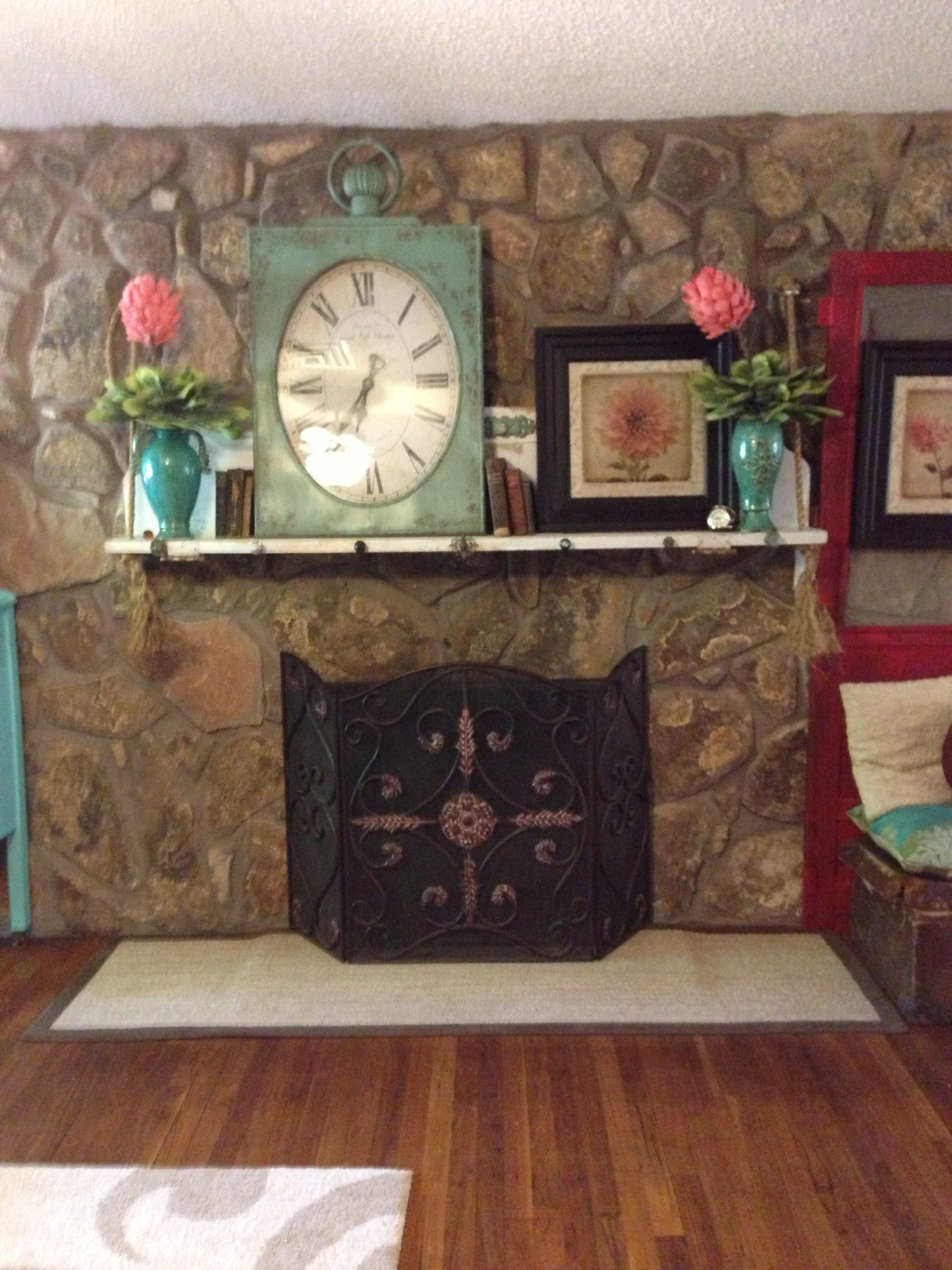 Fireplace mantel, made from a door.