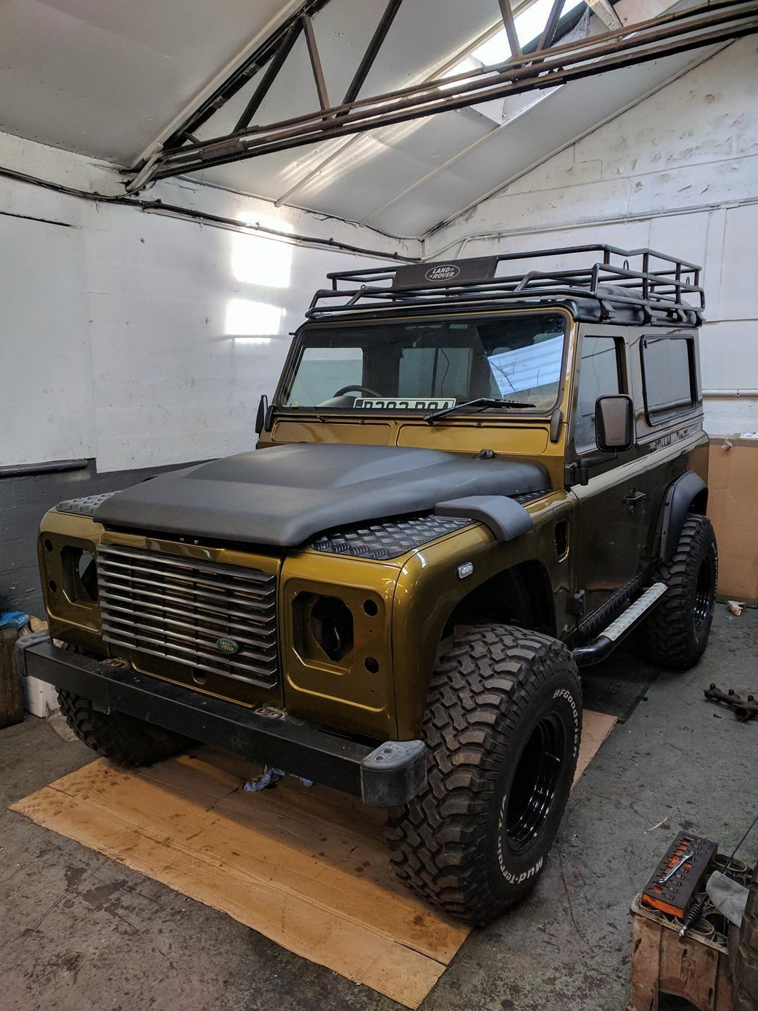 jacked landrover defender jacked creative thinking. Black Bedroom Furniture Sets. Home Design Ideas