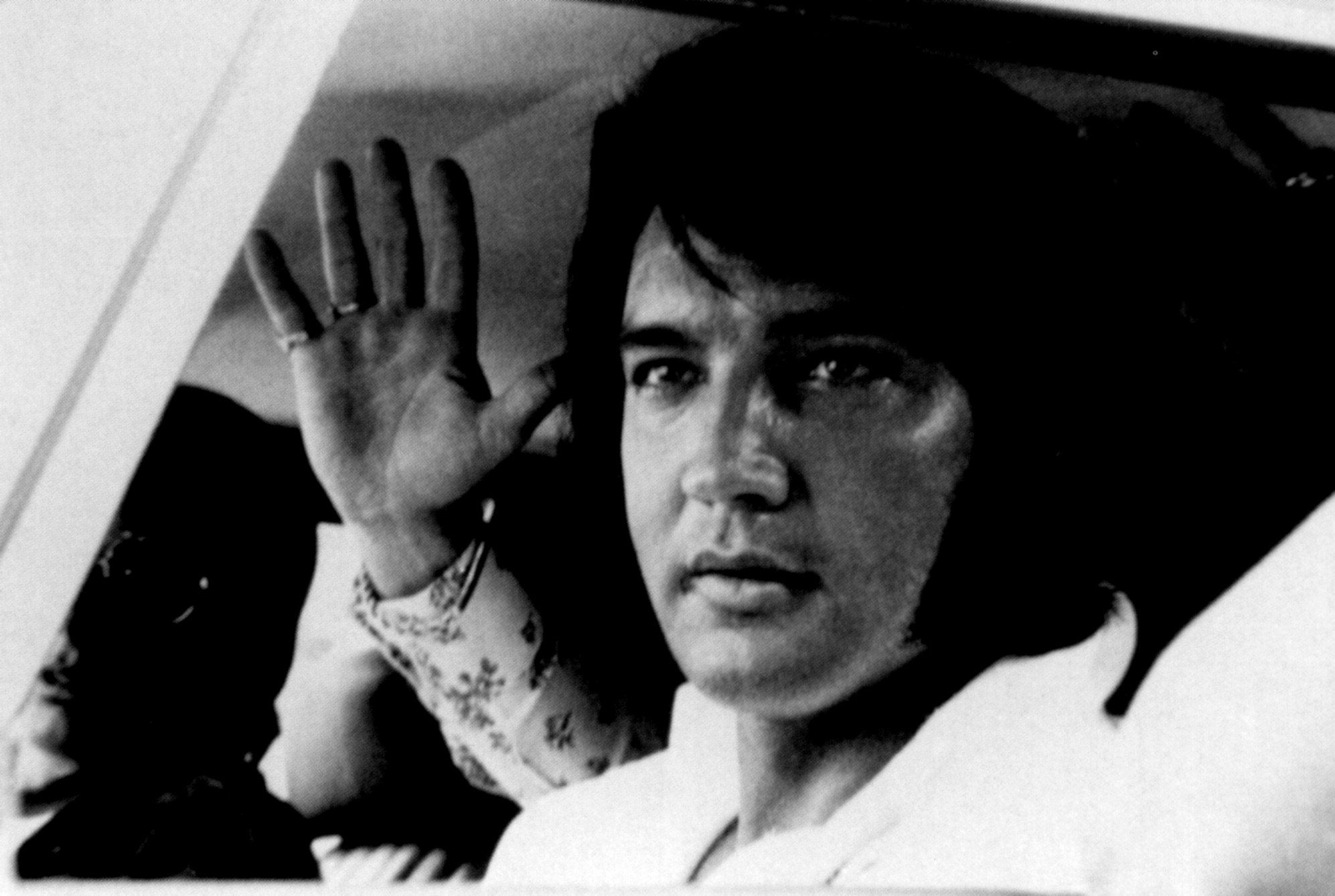 ELVIS DRIVING THROUGH THE GATES OF GRACELAND SOMETIME IN 1972