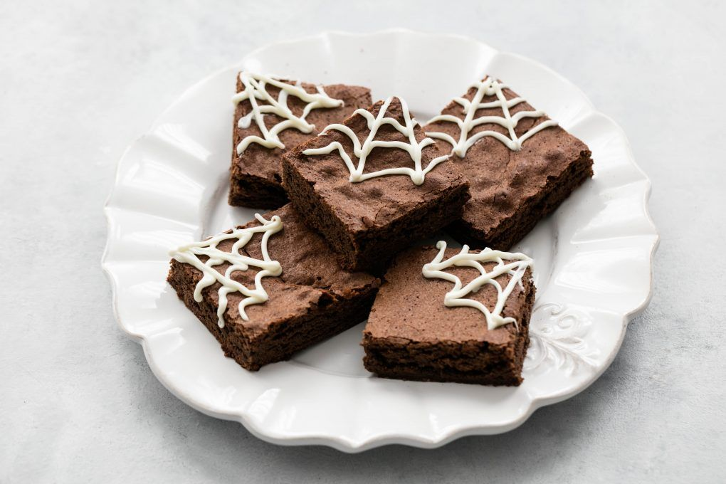 Easy, chewy, spider web halloween brownies are delicious and fun to make! #halloweenbrownies