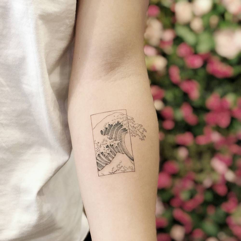 Photo of The great wave of Hokusai tattoo inked on the left forearm by Chang