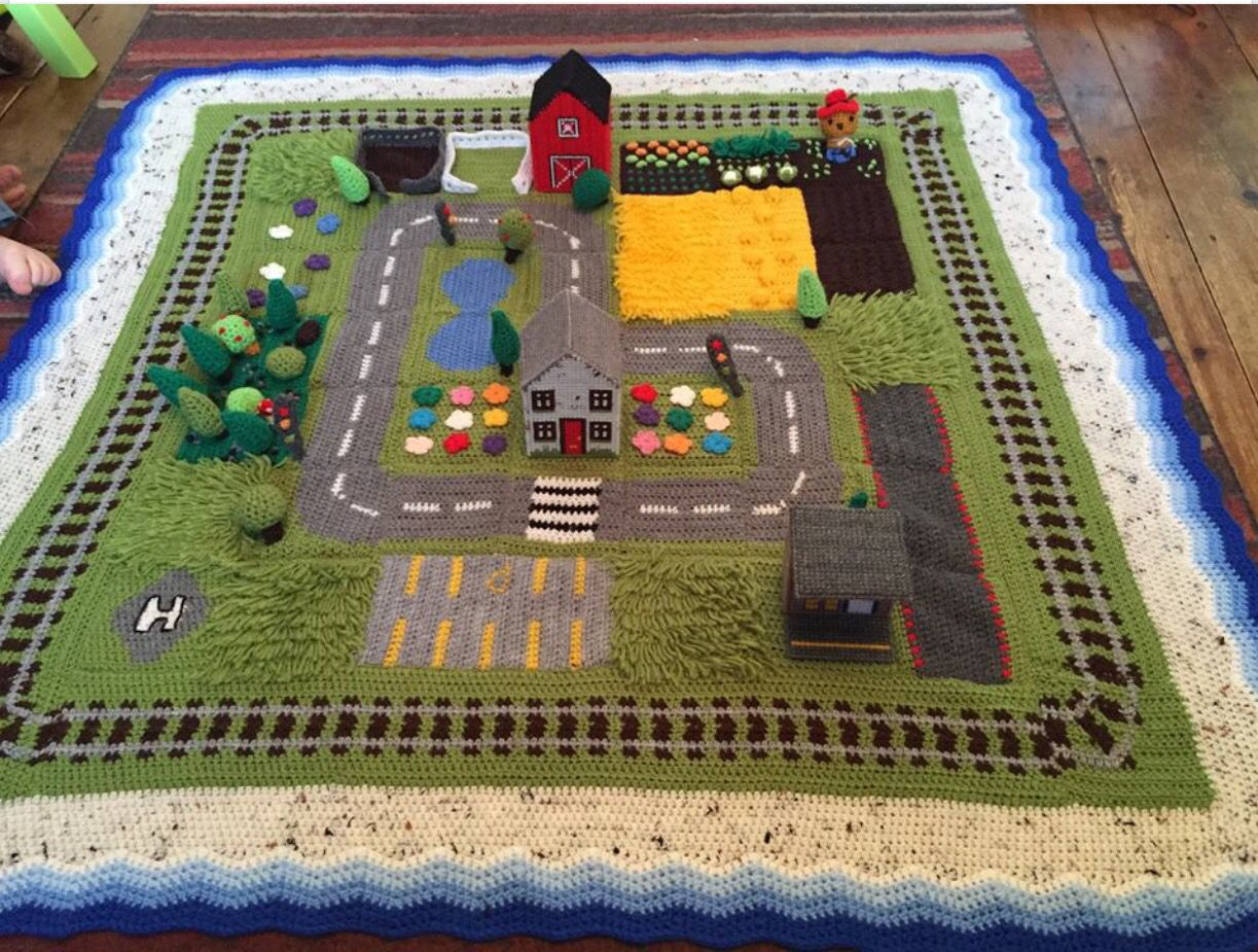 Oval Rugs Car play mat track if a mini town that has been crocheted
